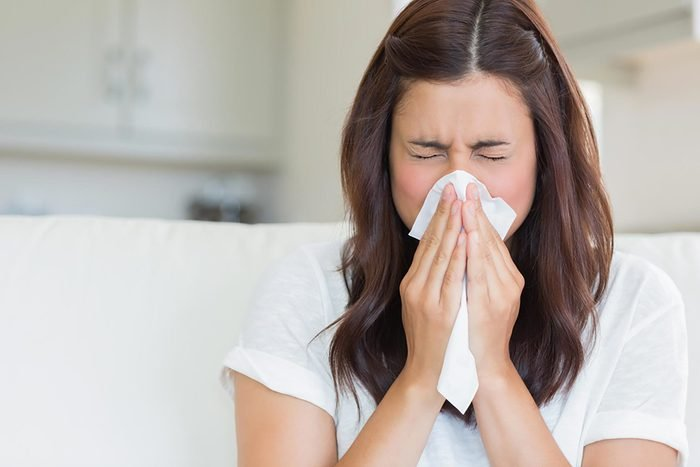 sneezing and woman blowing nose