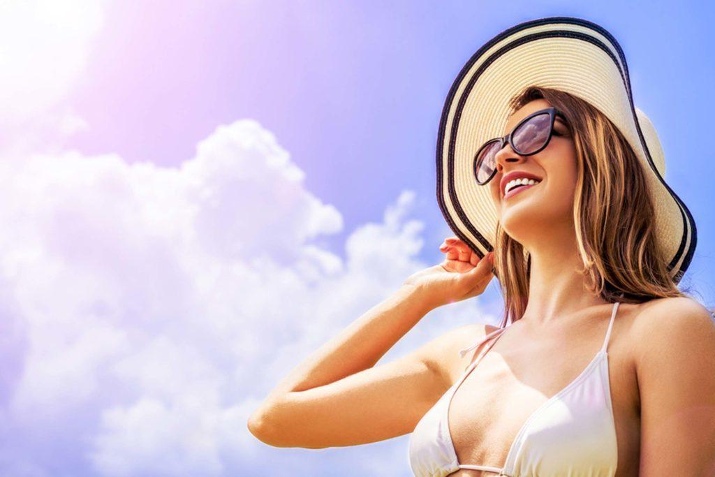 woman wearing sunhat outside