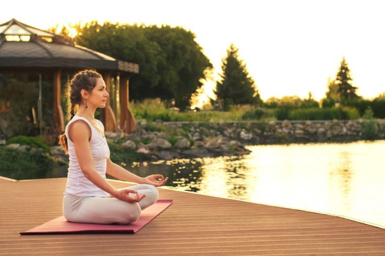 woman meditation on a dock