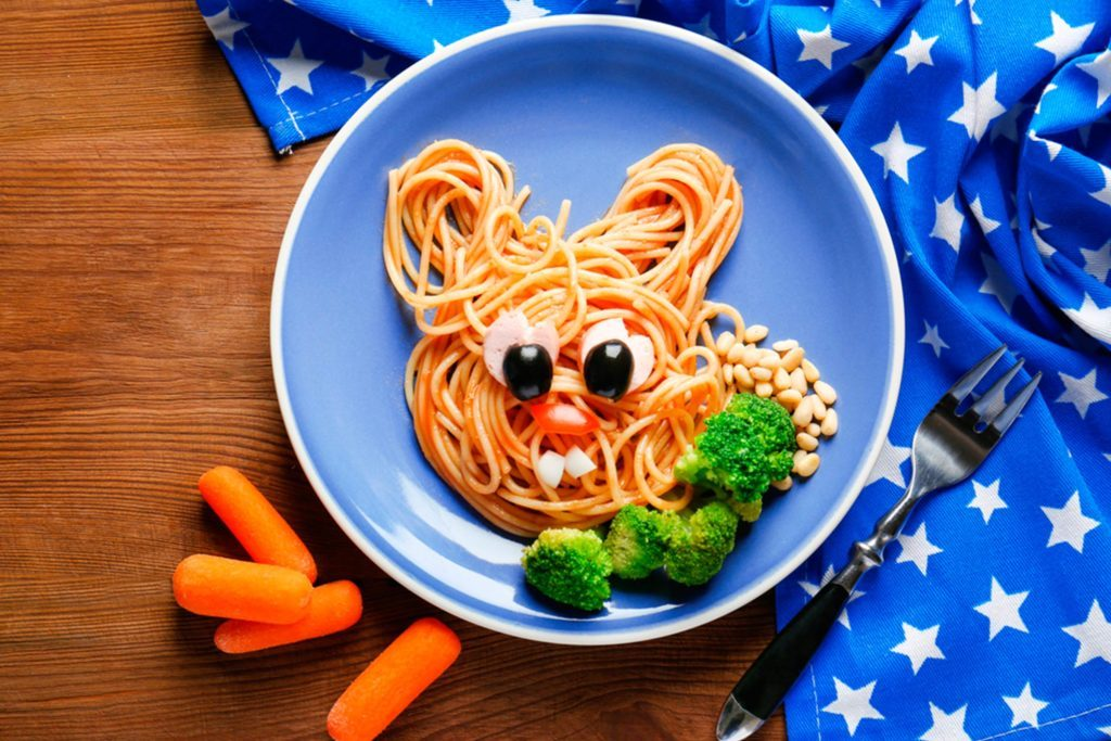 pasta swirled into bunny shape with edible face, broccoli, carrots