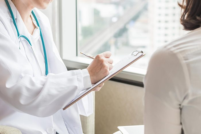 doctor meeting with female patient