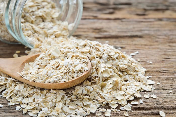 oats in a wooden spoon