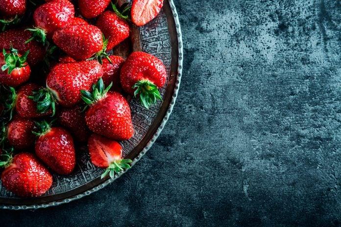 strawberries on a deep blue dish