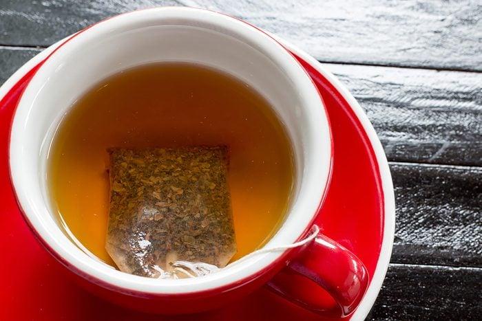 tea bag and tea in mug