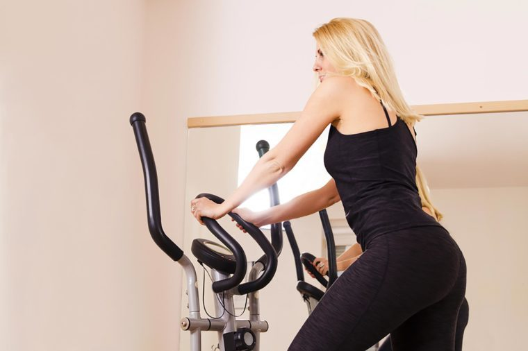 Woman using an elliptical.