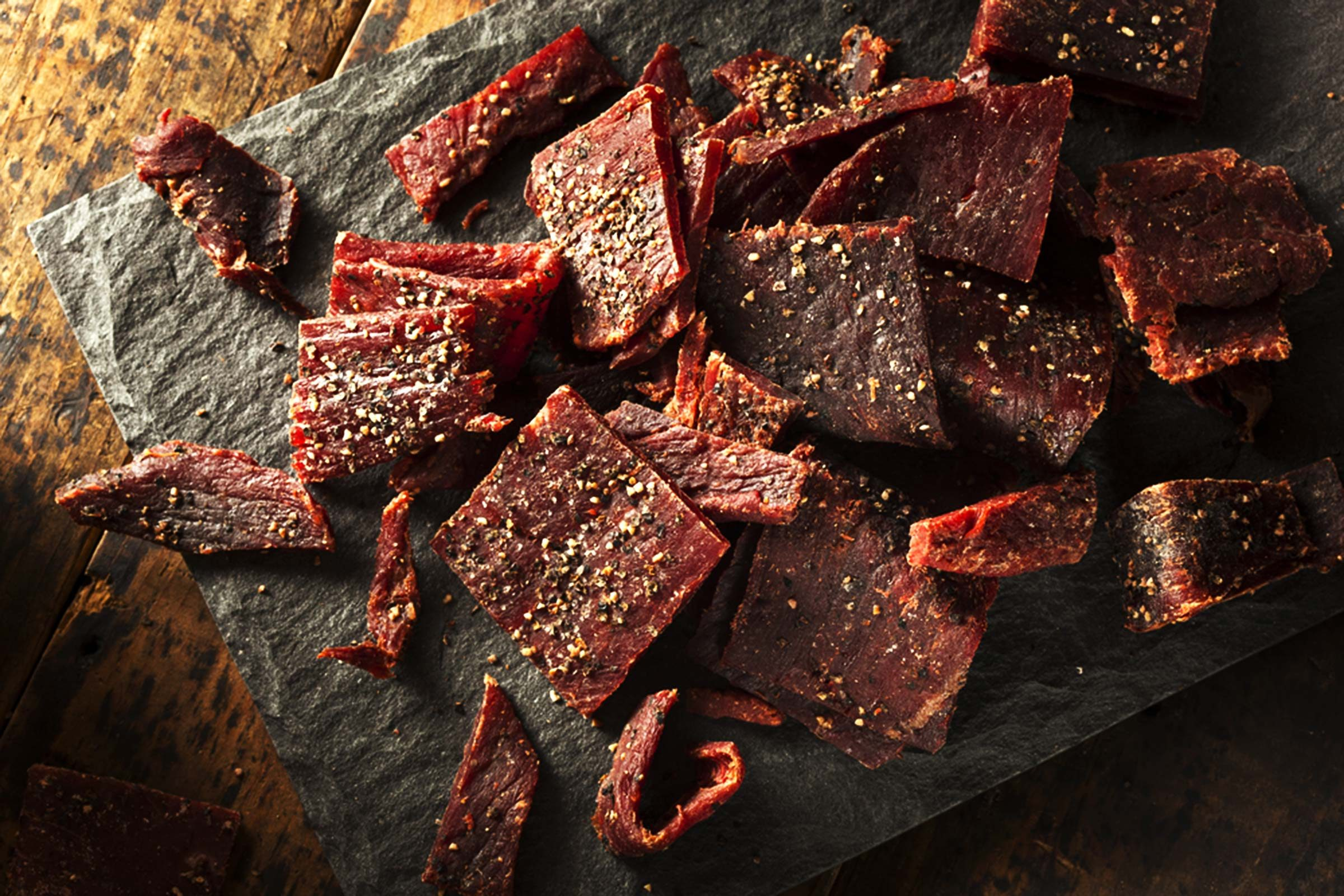 jerky on a granite cutting board
