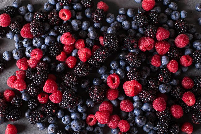 close up of mixed blueberries, raspberries and blackberries