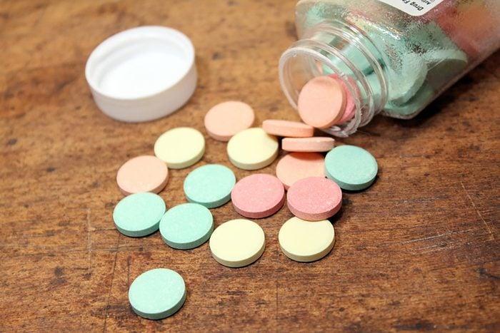 bottle of colorful antacids