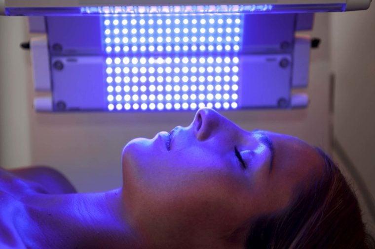woman getting photodynamic therapy