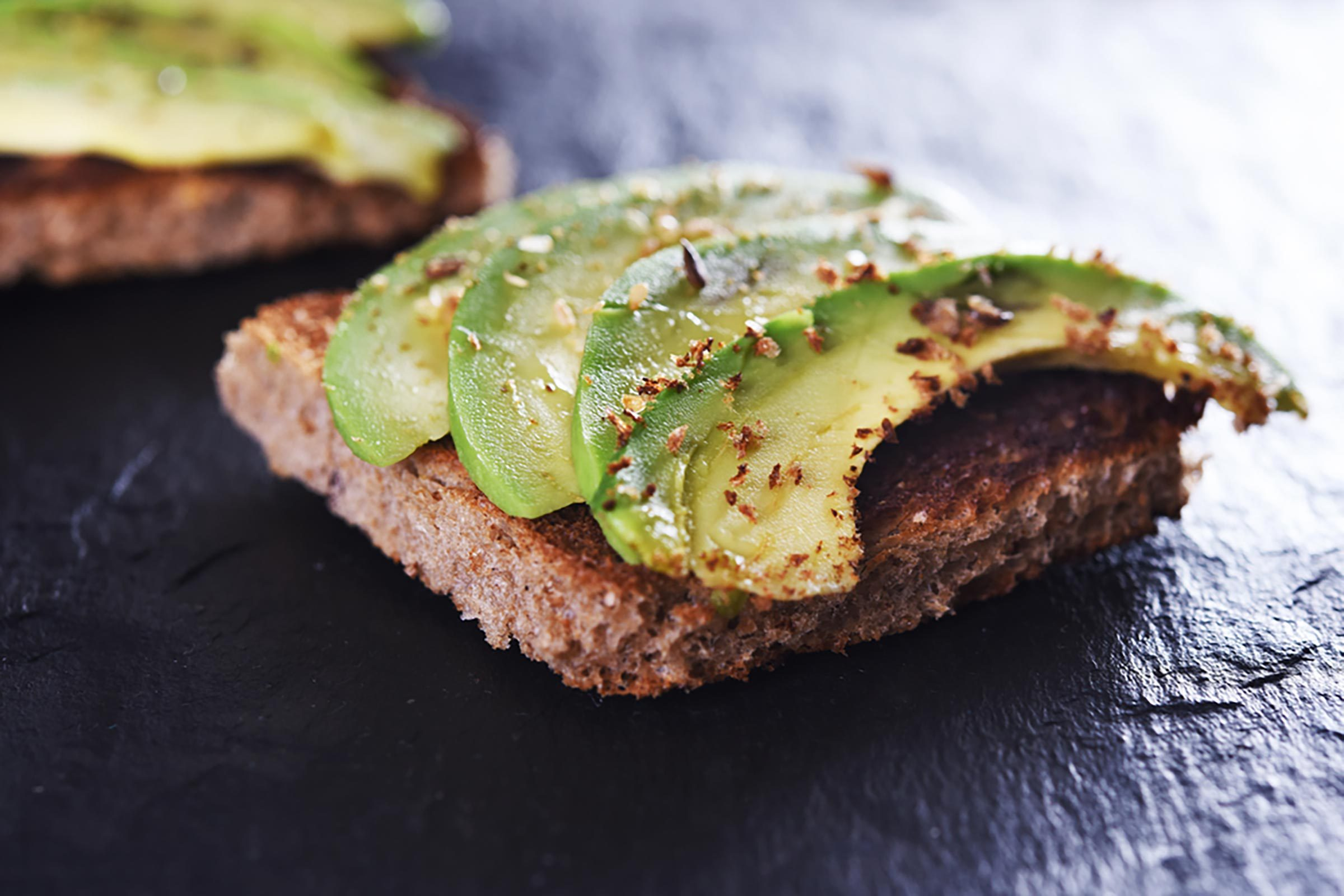 avocado slices on slice of toast