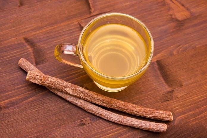 tea in mug and licorice sticks