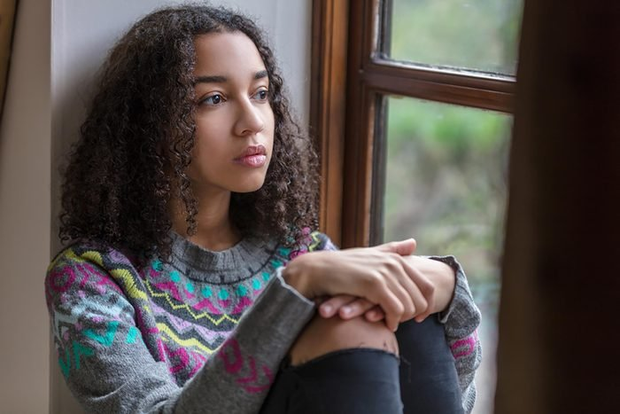 woman sitting at window