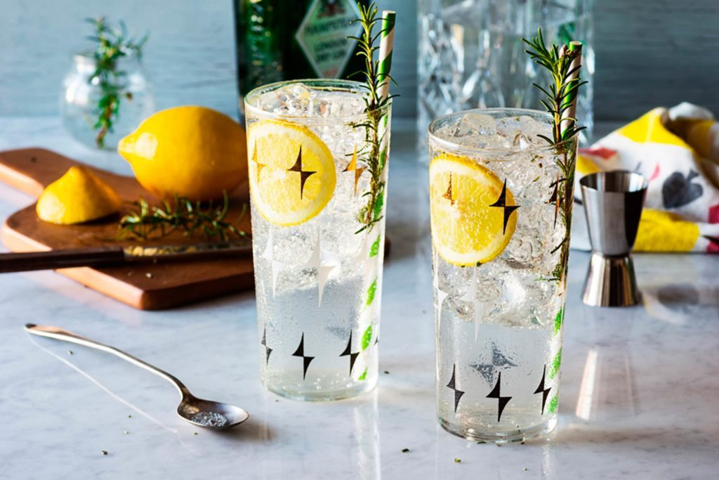 Two glasses of seltzer with lemon.