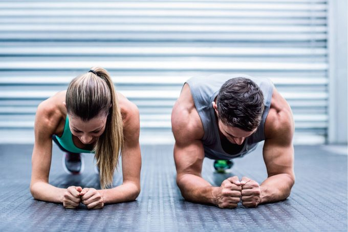 Man and woman working out together.