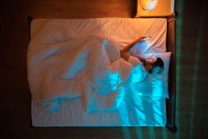 man with insomnia in bed