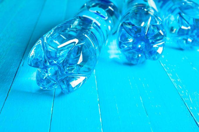 water bottles on their side, blue light