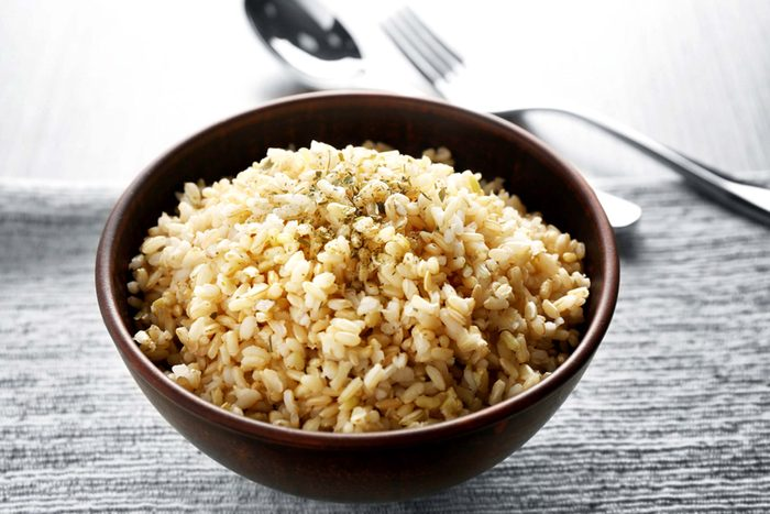 wooden bowl full of seasoned brown rice