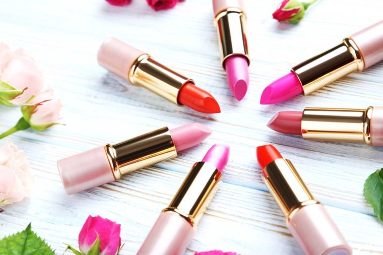 Six shades of open red and pink lipstick.