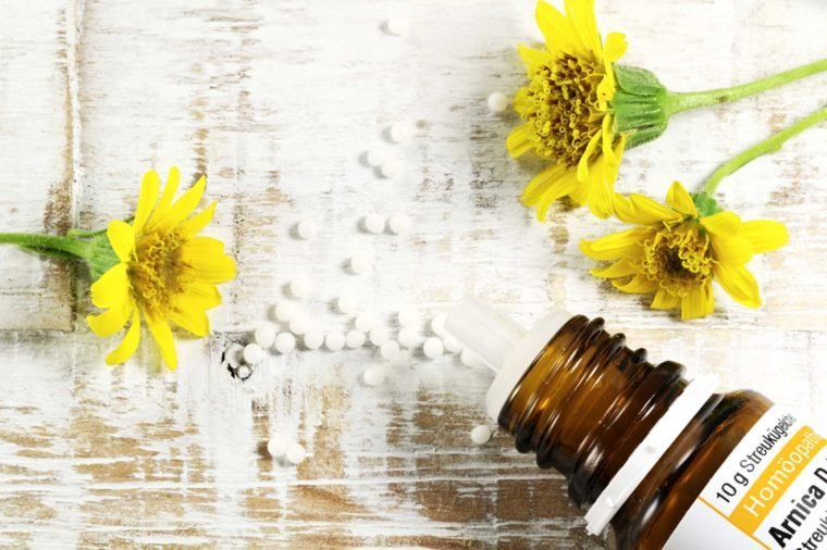 arnica flowers, bottle, and pills