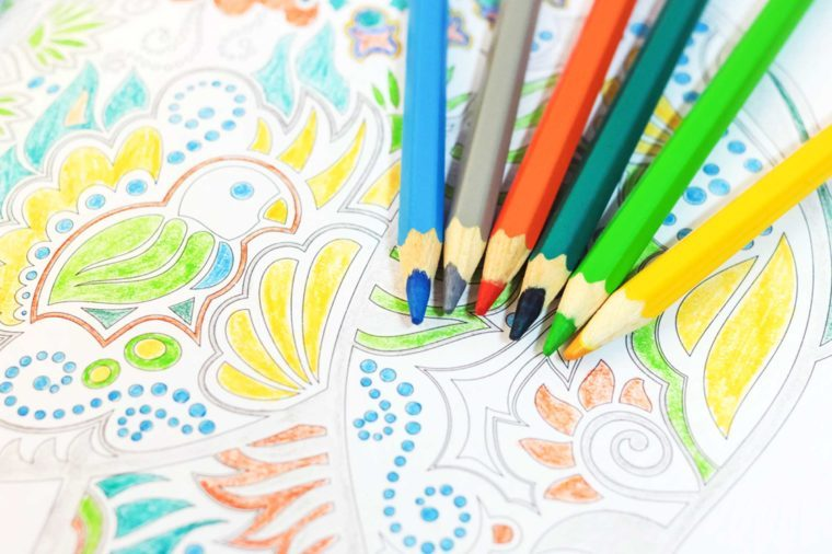 Colored pencils and an adult coloring book.