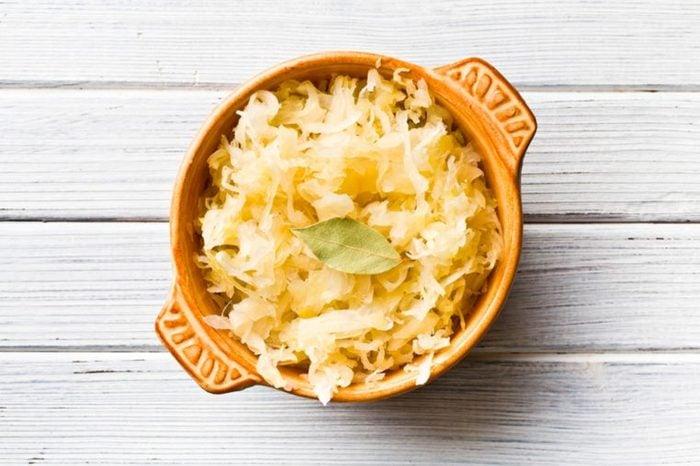 A bowl of sauerkraut.