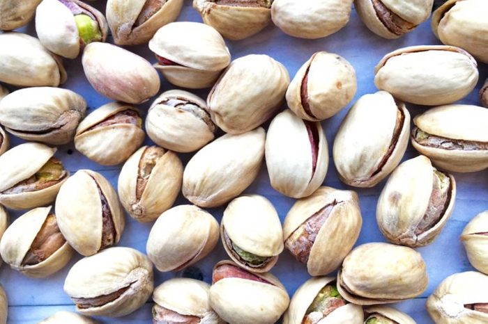 pistachios in the shell on a blue background
