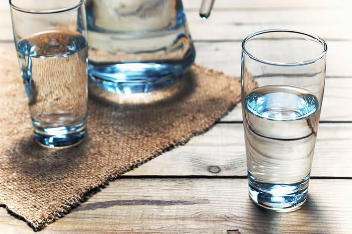Two glasses of water with pitcher