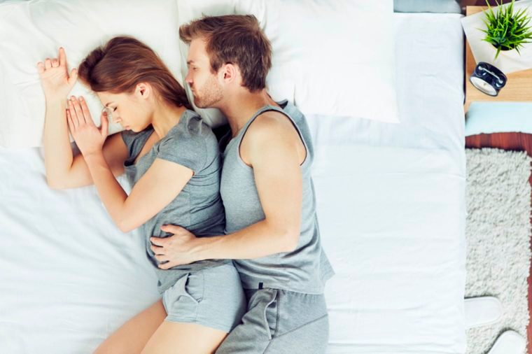 man and woman spooning in sleep