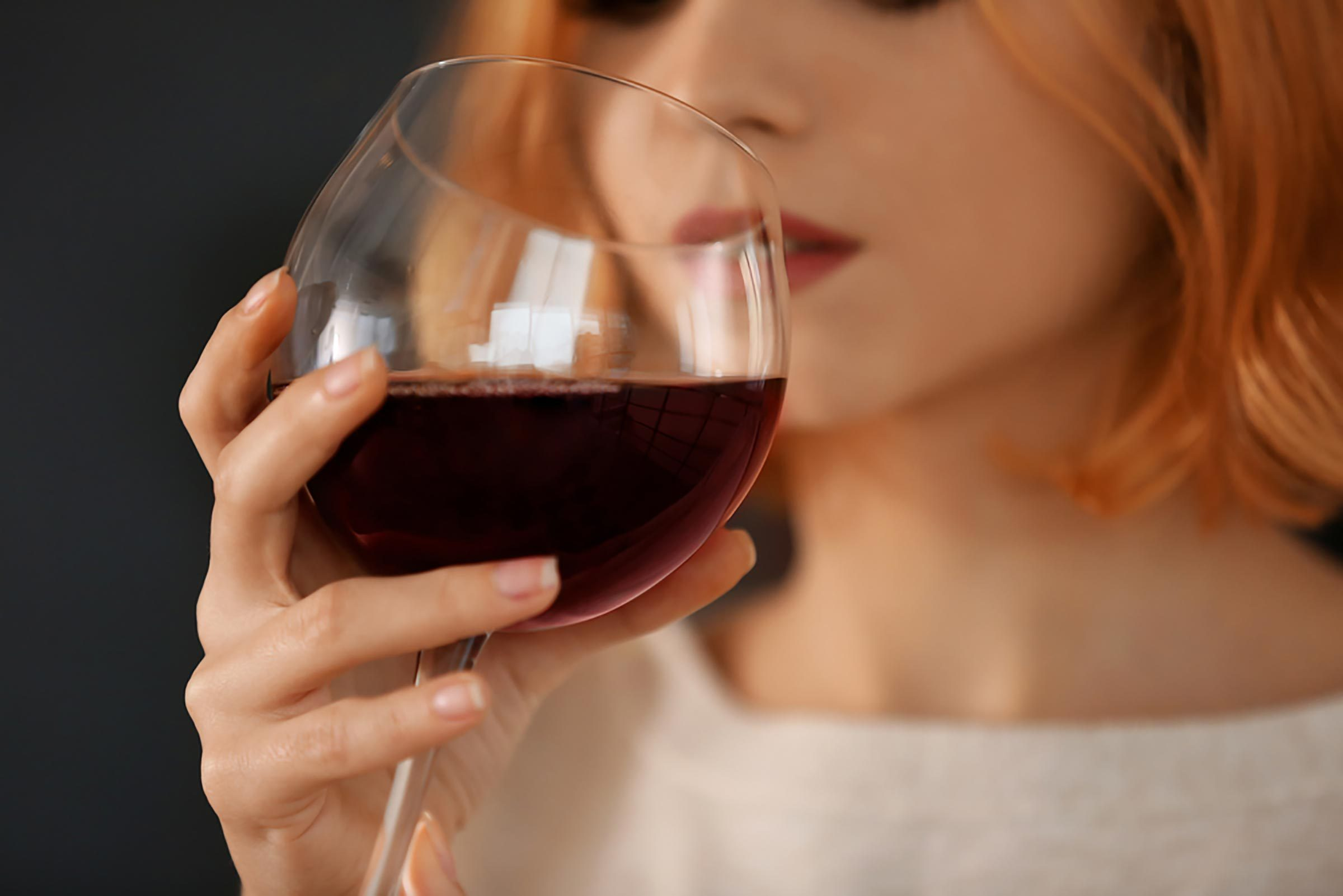 woman sipping red wine