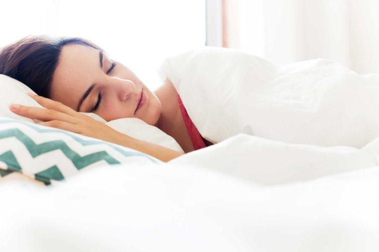 Sleeping woman in bed.