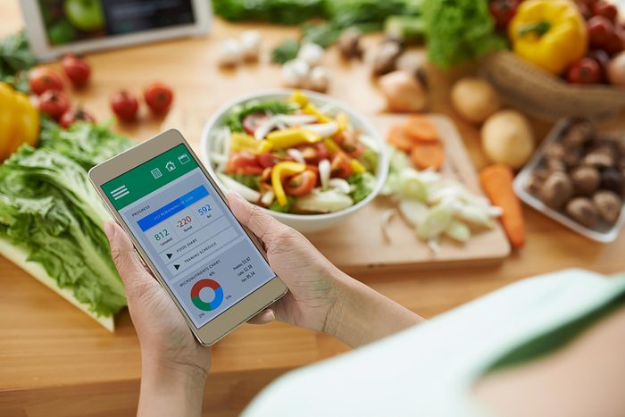 person tracking calories on phone