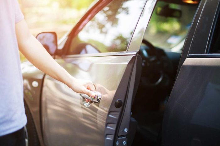 a person opening a car door