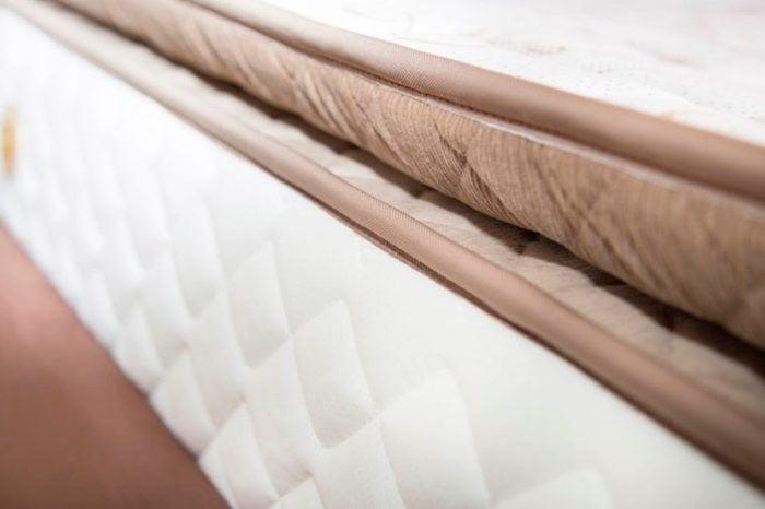 close up of mattress and mattress pad