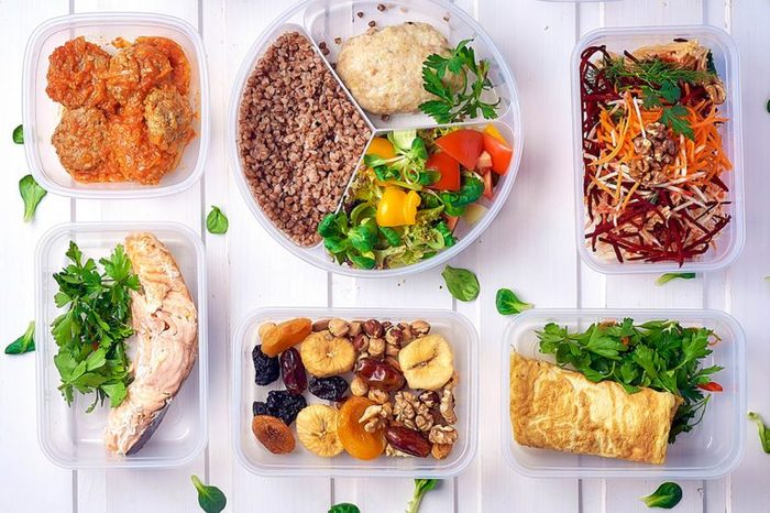 different types of healthy dishes in plastic containers