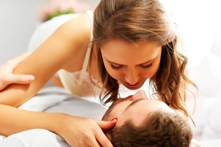couple in intimate embrace while lying down