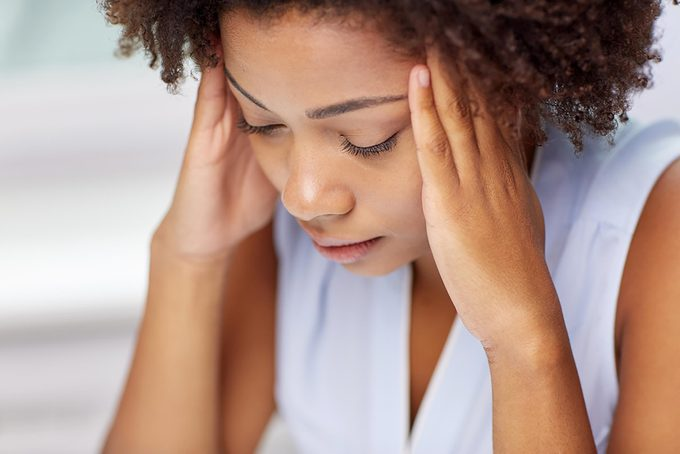 stressed woman with headache