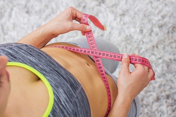 woman tape measure on waist