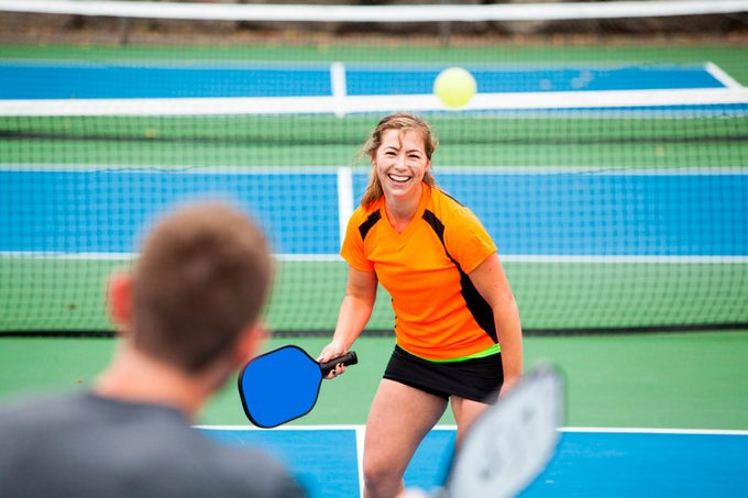 Couple playing pickleball