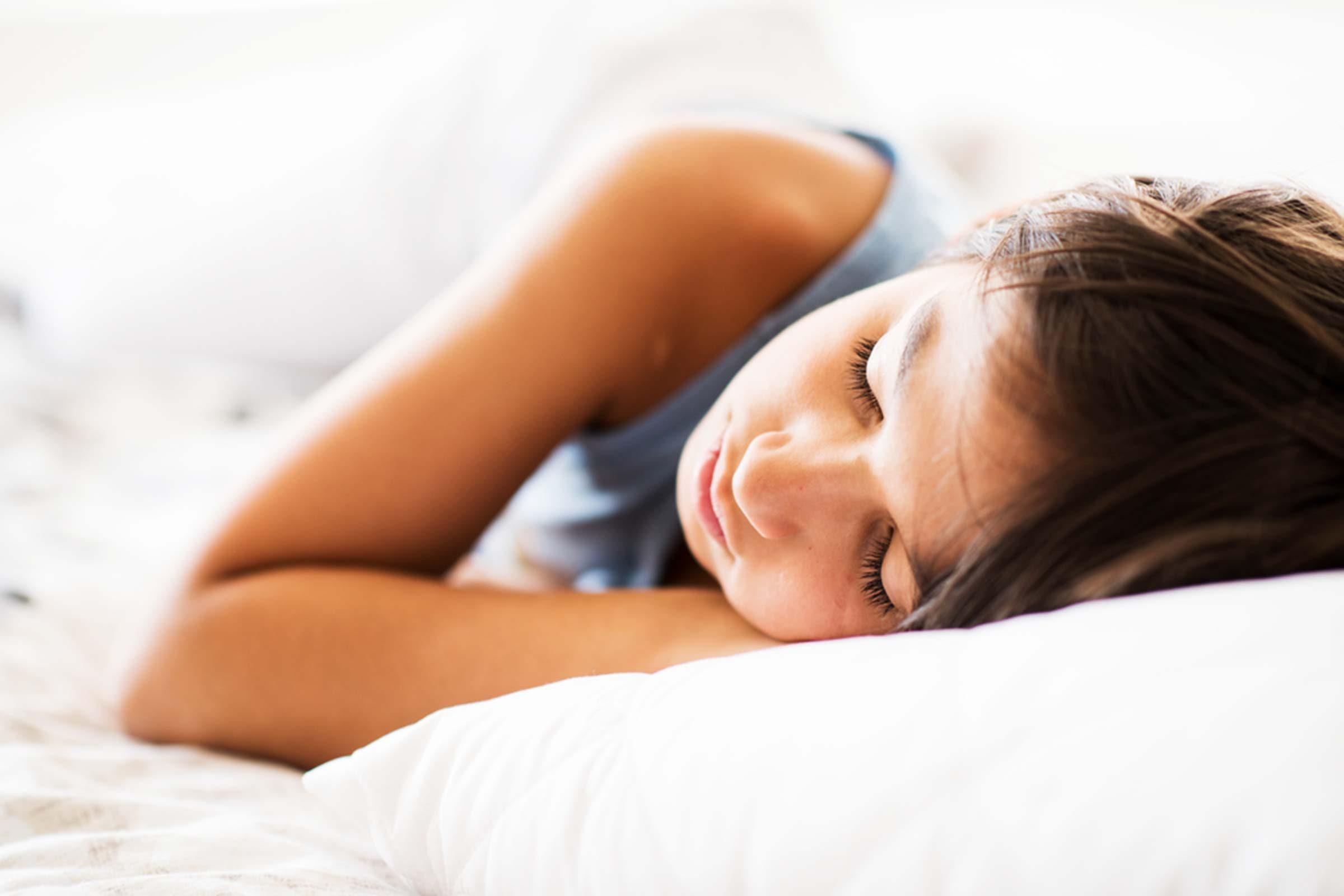 child sleeping on pillow