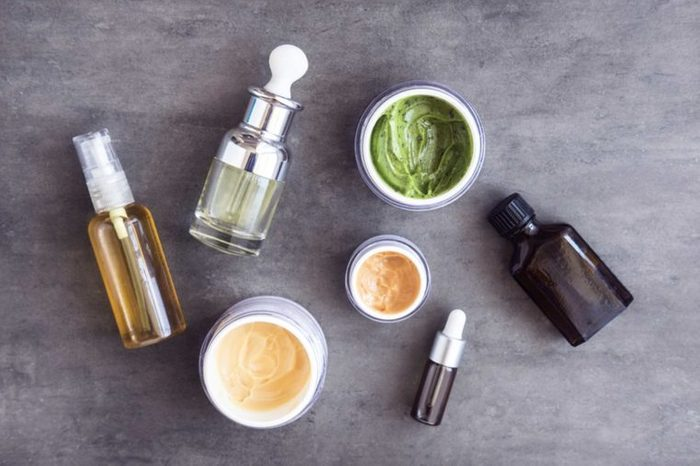Natural acne-treating ingredients in jars and bottles.
