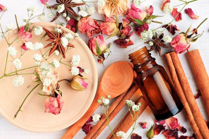 herbs, cinnamon sticks, and dried petals