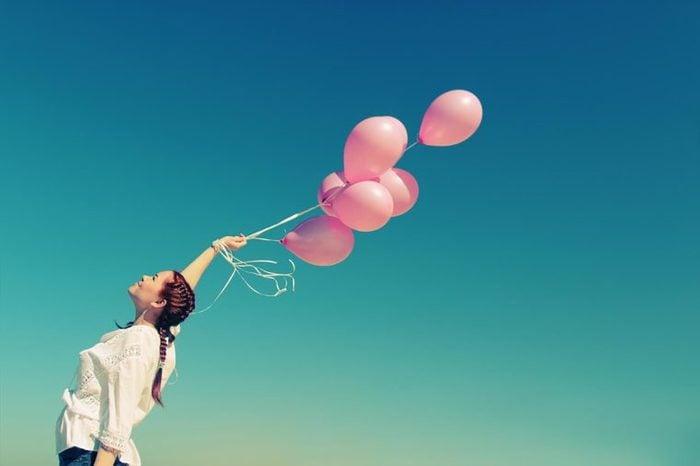 balloons woman optimistic