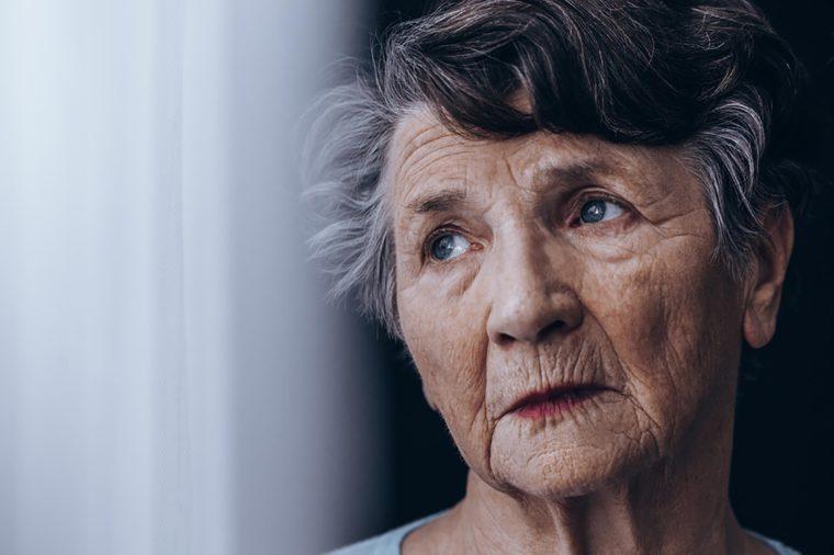 elderly woman looking sad