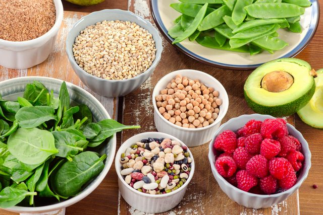 Healthful fresh foods, including spinach, raspberries, avocado and chickpeas