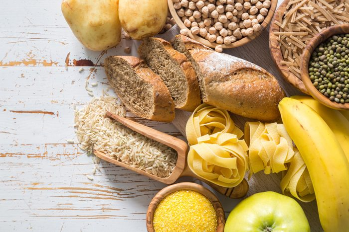 Bread, pasta, rice, corn meal and other carbs on a table