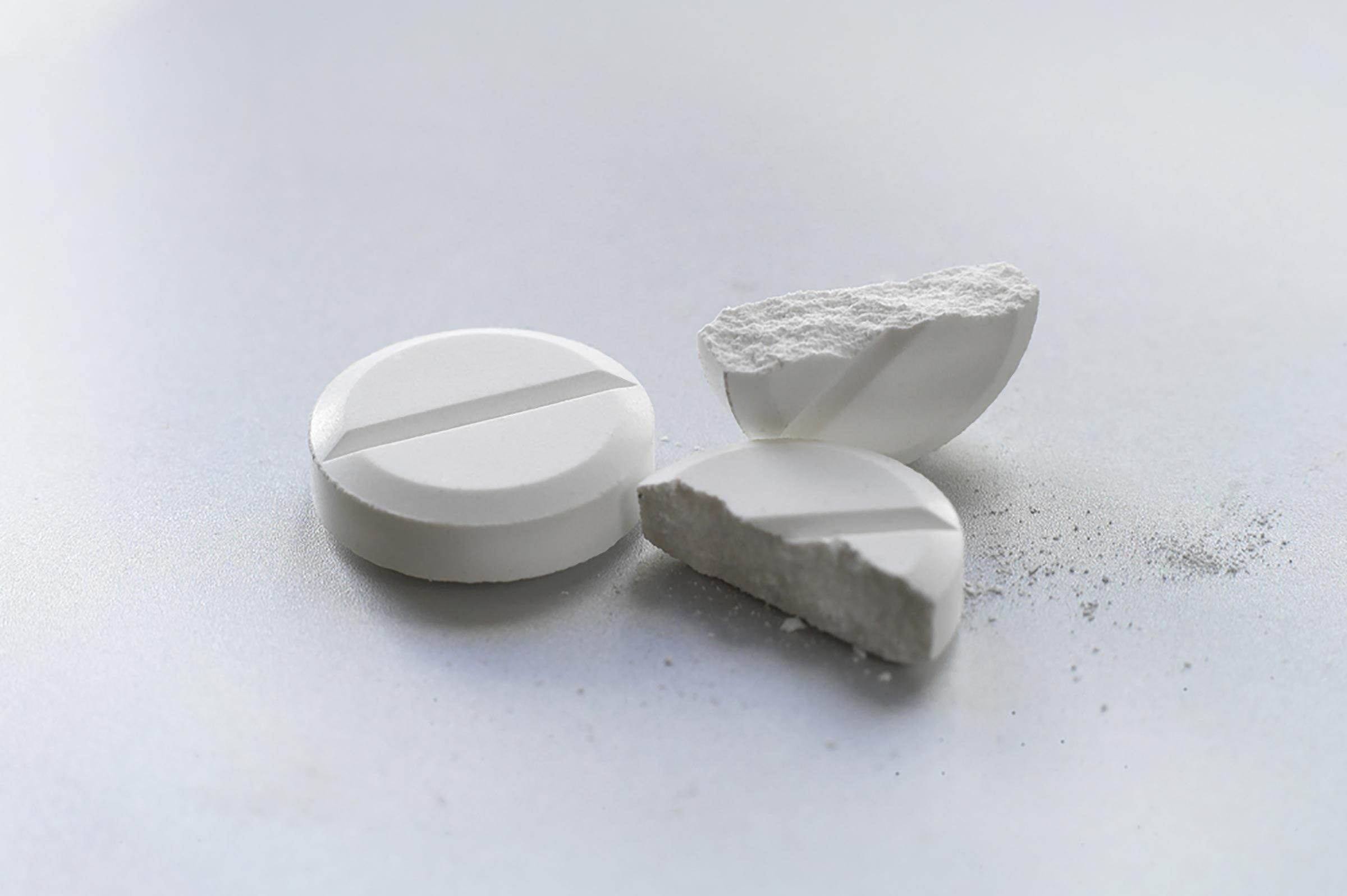 pain pills, one cut in half