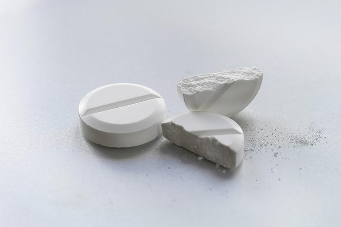 pain pills, one cut in half