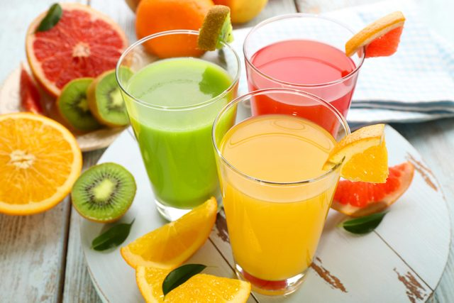 Orange, grapefruit and kiwi fruit juice blends in glasses