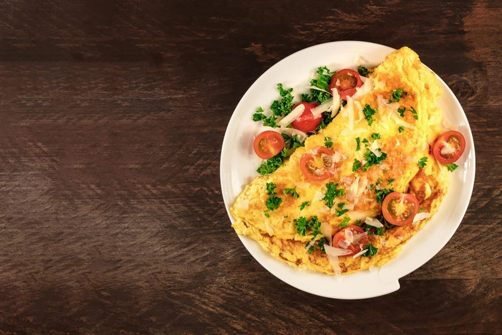 an omelette with fresh tomatoes and cheese