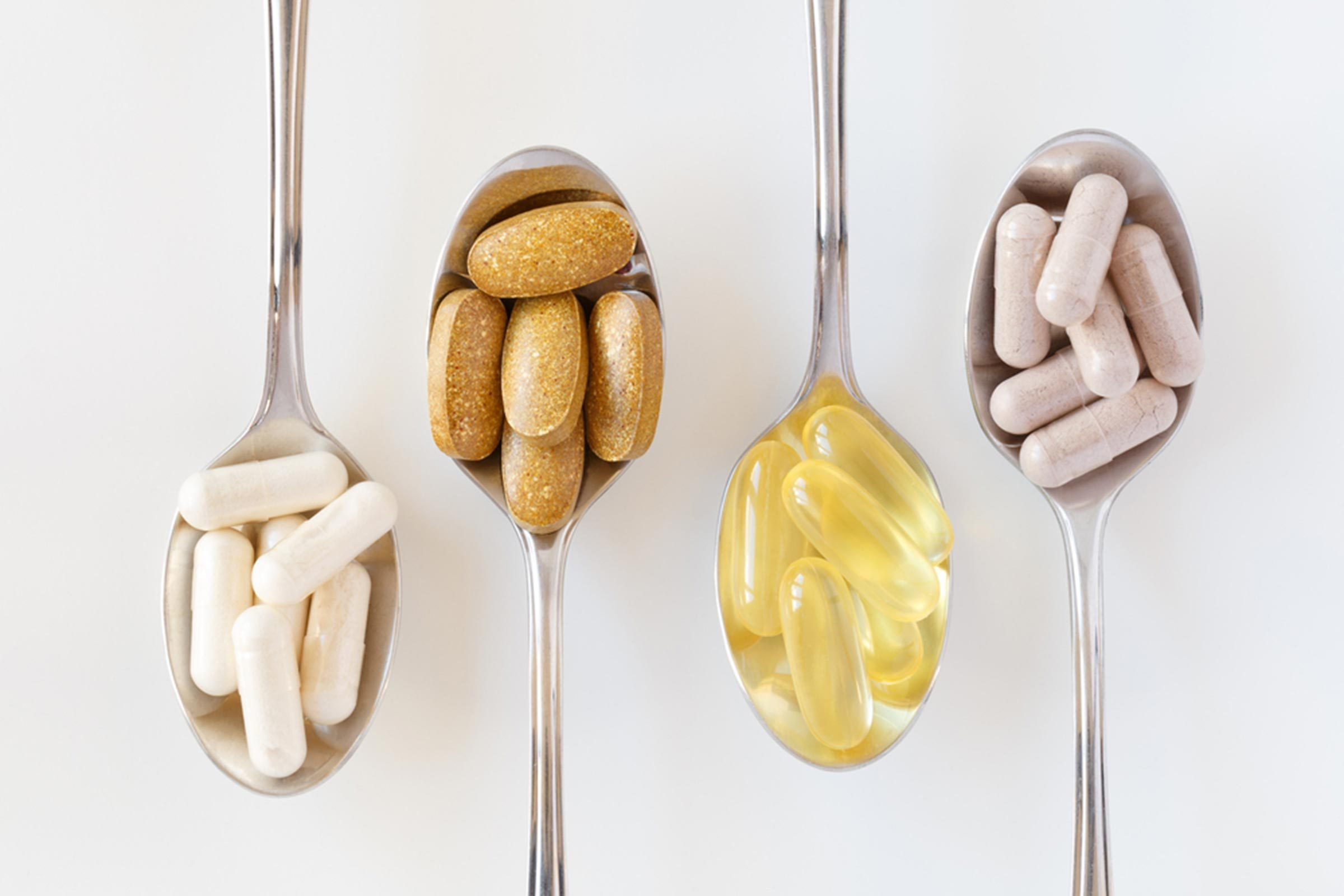 teaspoons holding different types of supplements